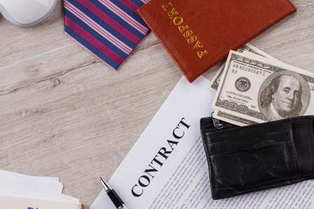 Contract, tie and passport. Making money process Office concept.