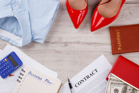 Contract and wallet with american dollars. Office womans flatlay close up. Purposeful in business.
