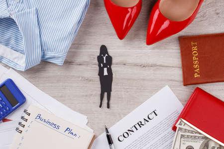 Passport, money and shirt. Things around clerk woman. Office concept.