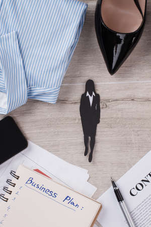 Figure of businesswoman in focus. Contract, pen and planner. Woman in business.