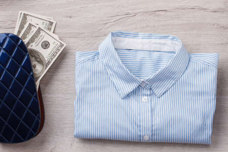 Office shirt and wallet with money. Daily attributes of clerk woman Office concept. 版權商用圖片