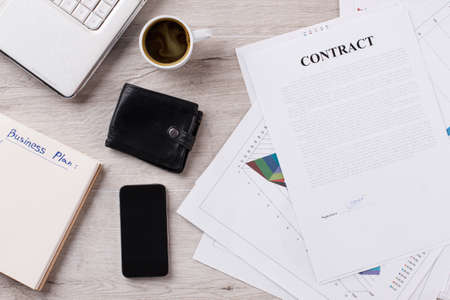 Personal items, americano and contract. Traders working place. Report generation.