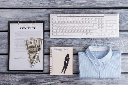 Office womens stuff wtih dollar bills. Beneficial deal is done. Successful woman.