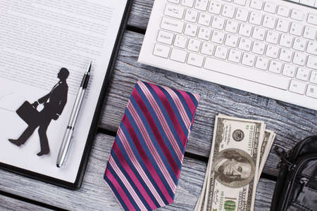 Money, tie and wallet. Successful businessman flatlay. Quality mens stuff on background.