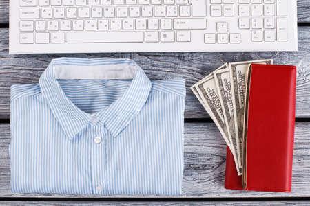 Classy wardrobe items, keyboard and money. White collar flatlay.