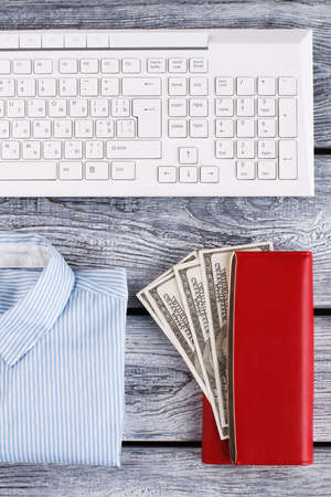 Office shirt, sum of money in wallet. White collar composition. 版權商用圖片