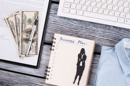 American dollars, pen and notepad . Business plan development. Office concept.