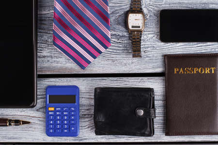 Passport, mobile phone and watch. Office man composition. Business concept.