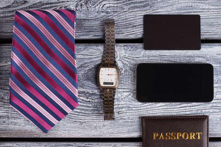 Watch, tie and smartphone. Businessman in details. Business concept. Banco de Imagens