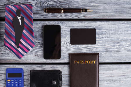 Passport, wallet and cellphone. Business collection.