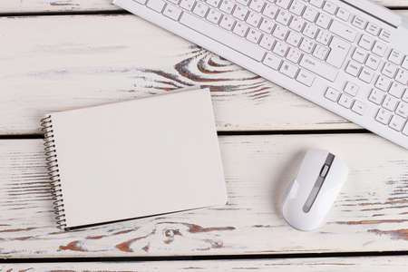 Planner with clean papers. Wireless keyboard and mouse. Office concept.
