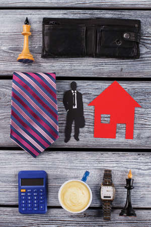 Calculator, watch and tie. Office clerk flatlay.