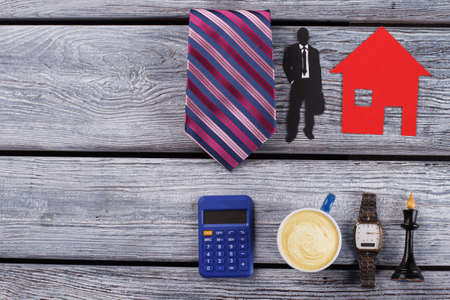 Pocket calculator, coffee, watch and chess. Flatlay on wooden background.