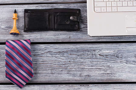 Tie and chess figure. Flatlay of office man, who loves chess play. .