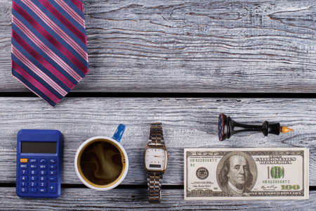 Calculator and money. Accountant flatlay. Time for coffee.