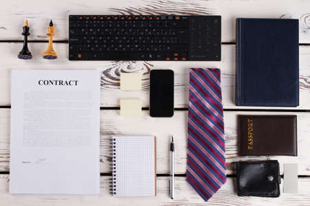 Passport, wallet and diary. Stationery, signed contract and devices. Businessman layout. Banco de Imagens