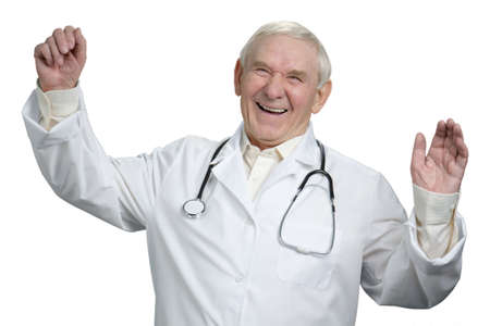 Senior doctor is laughing emotionally. Old doctor laughing out loud heartily in white isolated background. Stockfoto