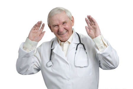 Very old doctor laughing raising hands up. Experienced senior physician having fun in white isolated background. Stockfoto