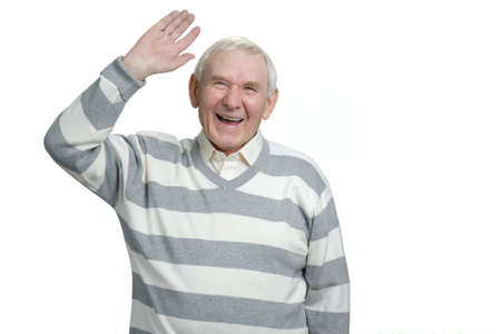 Very happy senior old grandfather is laughing heartily. Cheeful grandpa raising right hand up in white isolated background.