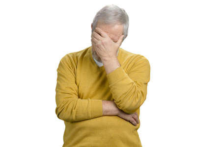 Portrait old grandpa doing facepalm. Extremely dissapointed and tired senior man. White isolated background.