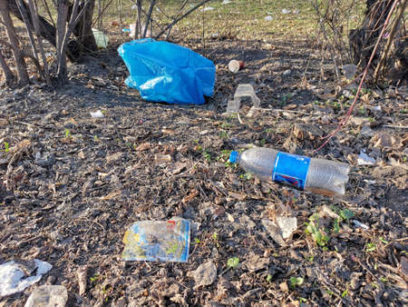 Close up waste on the ground. Bottle, plastic bags and cups. Stock fotó