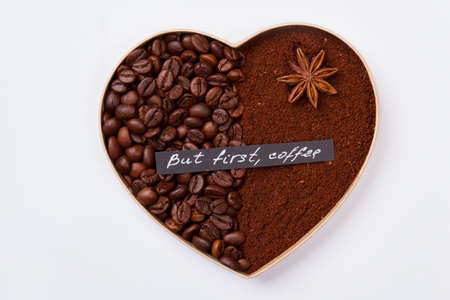 Coffee love concept. Decorative heart isolated on white. But first coffee.