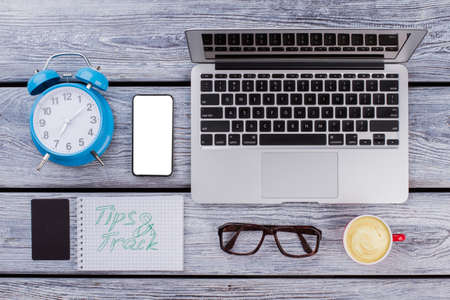 Tips track concept. Flat lay office accessories on wooden table. Standard-Bild