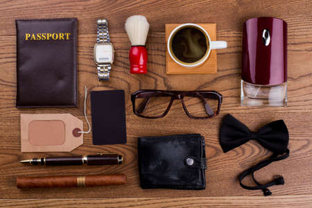 Accessories of a rich old man. Topview flat lay. Brown wooden surface.