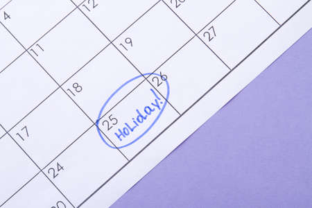 Signed a day of a calendar by a blue highlighter pen. Waiting for a holiday. Foto de archivo