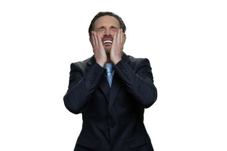 Wailing office employee in suit. Middle-aged manager is crying. Mature crying man isolated on white background. Stock Photo