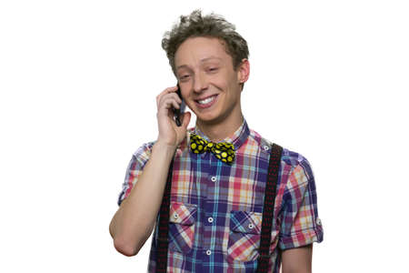 Teenage boys talking on phone. Happy cheerful young caucasian guy having phone conversation isolated on white.