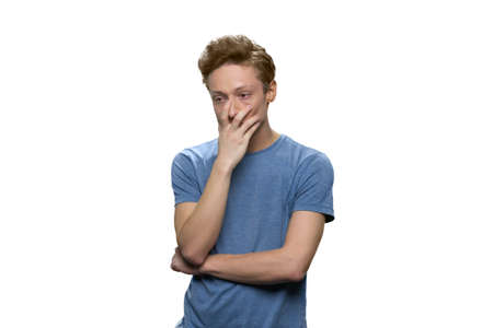 Portrait of teenage boy with depression. Touching face and thinking. Isolated on white background. 写真素材