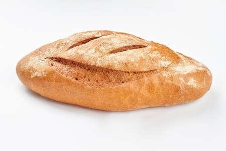 Loaf of organic bread on white background. Fesh whole grain bread. Natural food concept. Archivio Fotografico