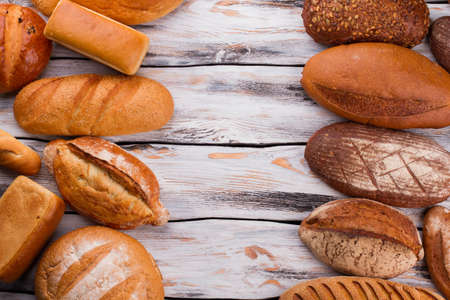 Bread frame on rustic wood background. Bread background with copy space. Natural organic food.