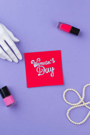 Beauty accessories on a womens day. Isolated on purple background.
