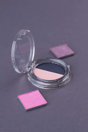 Close-up cosmetic powder boxes Round and square shaped cases with cosmetic powder.