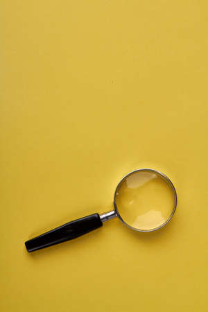 Magnifying glass on yellow background. Optical tool for zooming objects. Instrument for macro view.