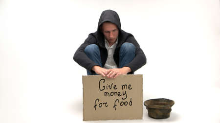 Give me money for food. Concept of crisis and unemployment due to covid-19 crisis. Man begs money for food with cardboard sign isolated on white background.
