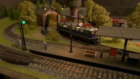 Miniature train station. Toy lokomotive on a railway.