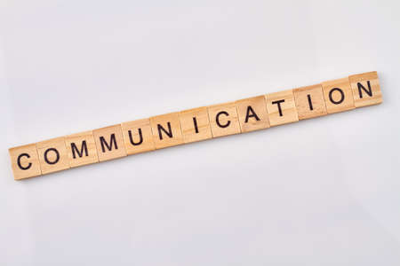 Communication is abstract concept. Wooden blocks with letters isolated on white background.