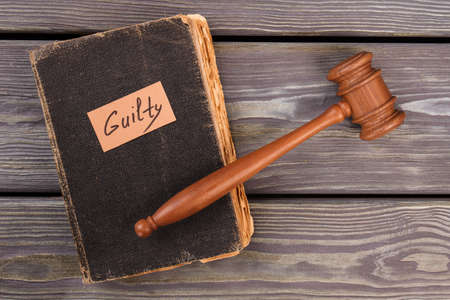Old book gavel and guilty verdict. Trial justice concept. Top view flat lay. Stock fotó