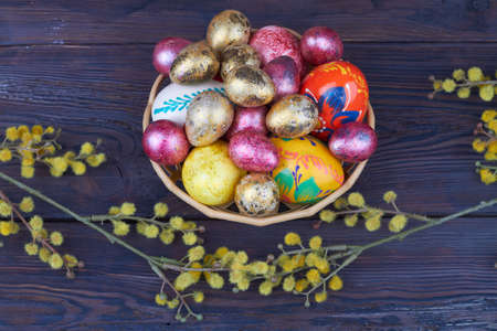 Pile of easter eggs and willow branches.
