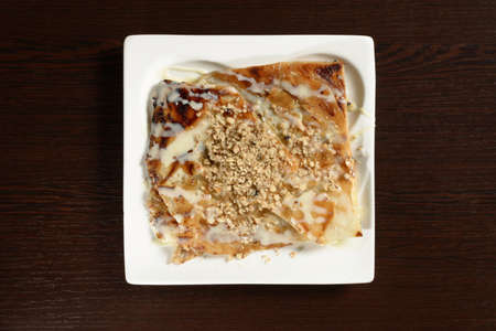 Traditional Turkish sweet with nuts and condensed milk, top view. Photos for restaurant and cafe menus