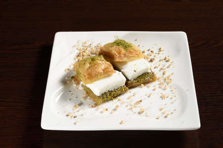 Turkish sweetness puff baklava with ice cream, two baklava on a plate. Photos for restaurant and cafe menus