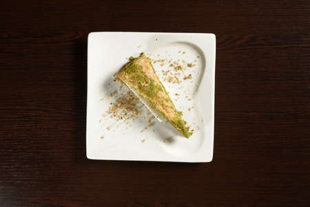 Turkish puff baklava with ice cream honey with pistachios triangular shape, top view. Photos for restaurant and cafe menus