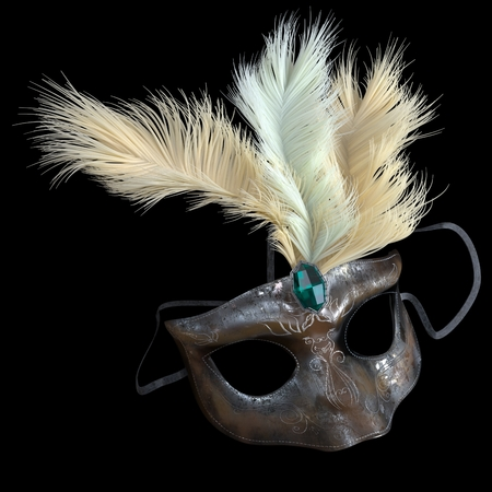 metal carnival mask with feathers on isolate black photo