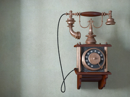 Vintage telephone on old wall concept background photo