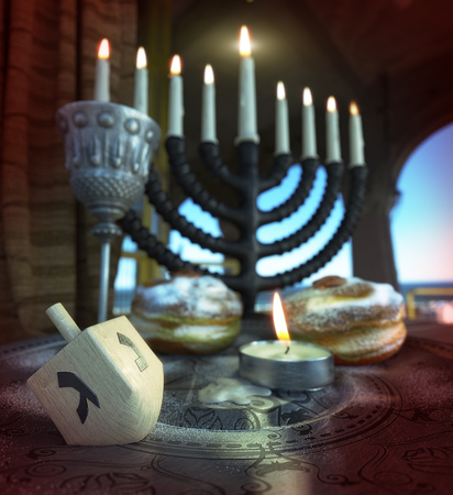 lamp light: hanukkah background with candles, donuts, spinning top Stock Photo