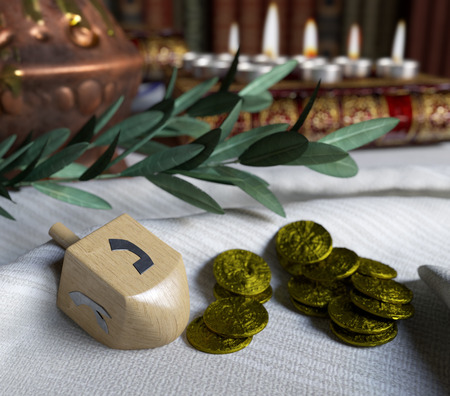 antique coins: hanukkah close up with candles,spinning top and gold antique coins Stock Photo