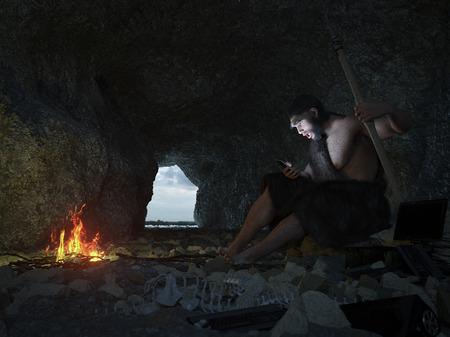 stone age: primitive man siting in the cave with smartphone concept illustration